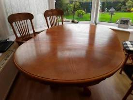 Circular 4ft dining table extends to a 6ft.,.